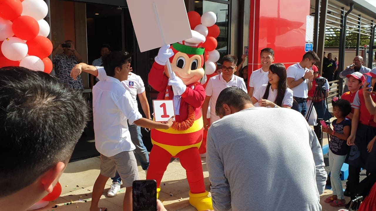 Customers queue for a taste of Jollibee, milestone store opens on